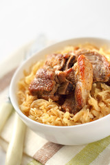 Pork ribs baked with sauerkraut