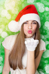Excited Santa girl blowing kisses