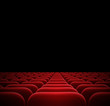 red seats in dark cinema theater