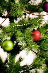 christmas decorations hanging on christmas tree