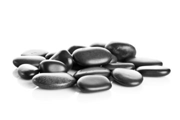 Black massage stones isolated