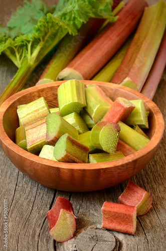 Fresh rhubarb on wooden garden table