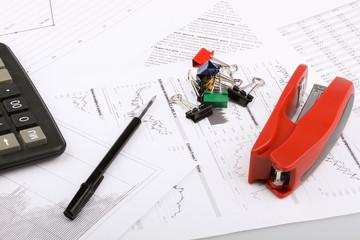 Business still-life of a paperclips, stapler, calculator