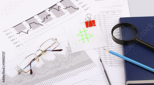 Business still-life of a pen, glasses, magnifier, diary
