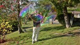 illusionist and large soap bubbles