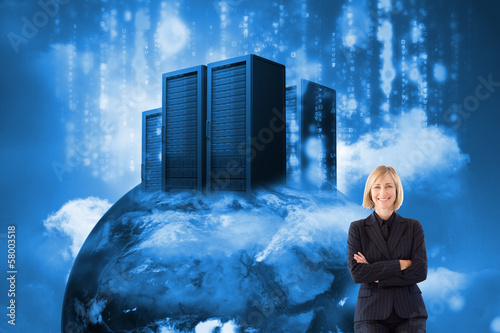 Composite image of friendly businesswoman smiling at the camera