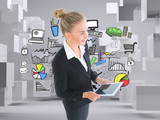 Composite image of businesswoman holding new tablet - 58004763
