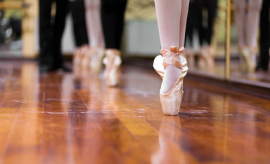 Ballerinas dancing standing in pointe position