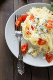 appetizing pasta with cheese and tomato