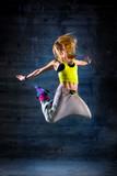 Fototapety Woman dancing in urban environment