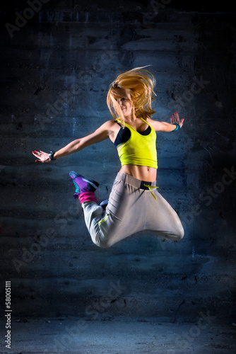 Woman dancing in urban environment
