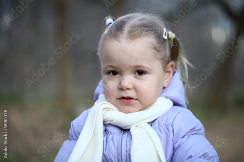 Autumn portrait of a beautiful little girl