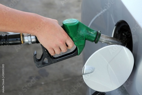 Gas Station Refill Hand and Nozzle
