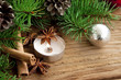 Holiday decoration with candle,fir and cinnamon on wooden backgr