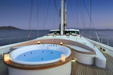 jacuzzi onthe deck of luxury sailboat