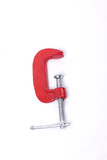 Red clamp on a white background