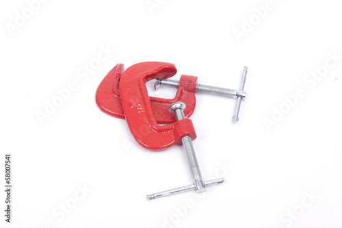 Red clamps on a white background