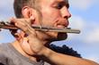 canvas print picture - Mann spielt auf einer Querflöte - Nahaufnahme