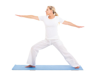 middle aged woman practicing yoga
