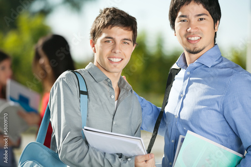 Male Friends Smiling On College Campus
