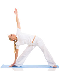 fit middle aged woman yoga pose