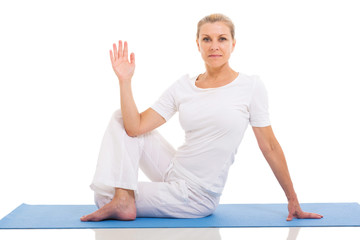 middle aged woman yoga pose on white