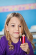 Girl Holding Bunch Of Color Pencils In Preschool
