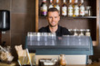 Smart Male Bartender At Counter In Cafe