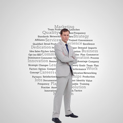 Composite image of serious businessman standing with his arms fo