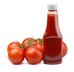 Ketchup bottle and fresh tomatoes