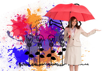 Composite image of happy businesswoman holding umbrella