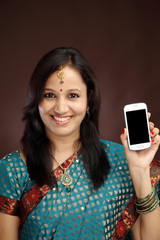Happy young traditional woman showing picture of herself