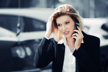 Young businesswoman calling on the mobile phone