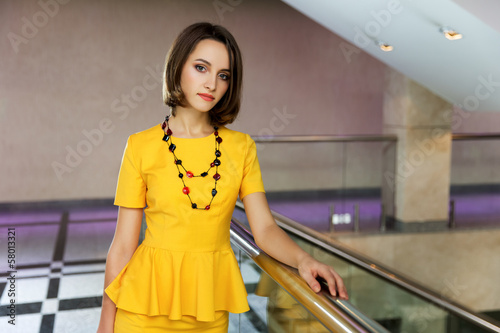Young business woman in office interior