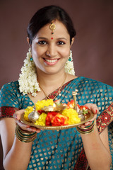 Smiling young traditional woman