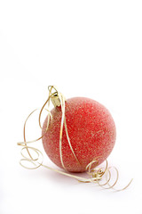 Single red frosted bauble with gold ribbon on a white background