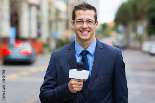 news reporter live broadcasting on street