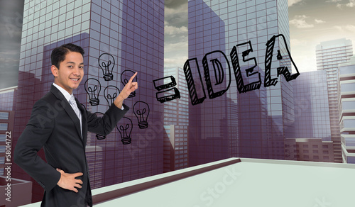 Composite image of smiling asian businessman pointing