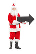 Smiling Santa Claus holding an arrow pointing right
