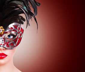 Girl in red carnival mask