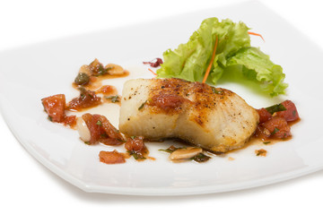 Grilled halibut with tomato concasse.
