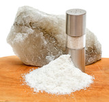 Rock salt with saltshaker and scattered salt