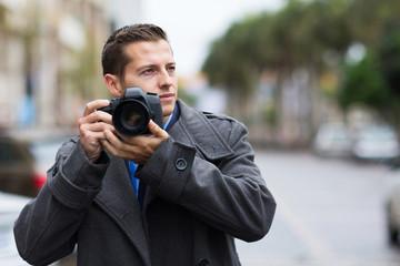 thoughtful photographer on street