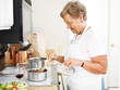 grandmother cooking in the kitchen - 58016553