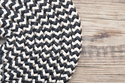 a rope is twisted on old wooden background
