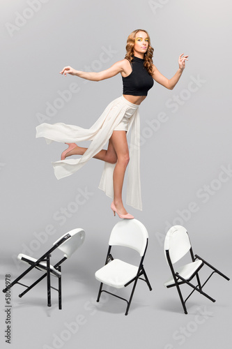 Fashionable woman balancing