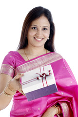 Young traditional woman holding gift box