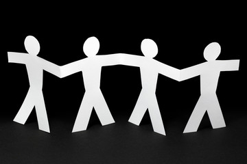 white paper people on black background