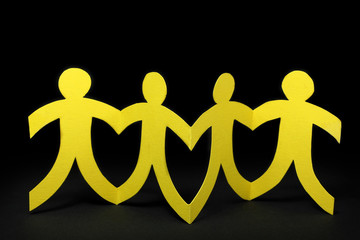 yellow paper people on black background