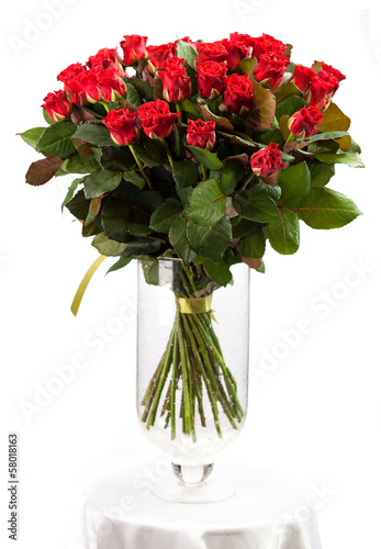 Bouquet of red roses over white background